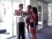 Lesbian girl fingers her friend's ass while she rides on the trainer's big dick