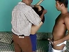 A horny brunette babe getting hard and deep fuck by two black cock