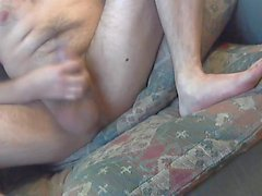 Stroking my cock and balls watching porn
