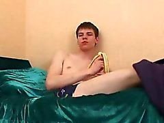 Twink teaser peels a banana and beats his meat