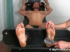 Beau Reed is tied up while two perverts are tickling him hard