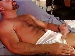 Muscle bear self ball punishment