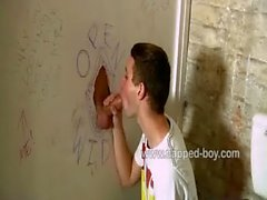 Hot twink Aiden Jason sucks cock trough a gloryhole