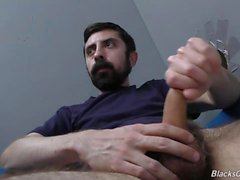 Bearded white man sucking and fucking a black cock at a gloryhole