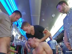 Horny Men Take Down a Cocky Hustler at a Busy Sex Arcade - Scene 1
