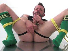 Morgan Black jerks off while tied and gagged in this solo